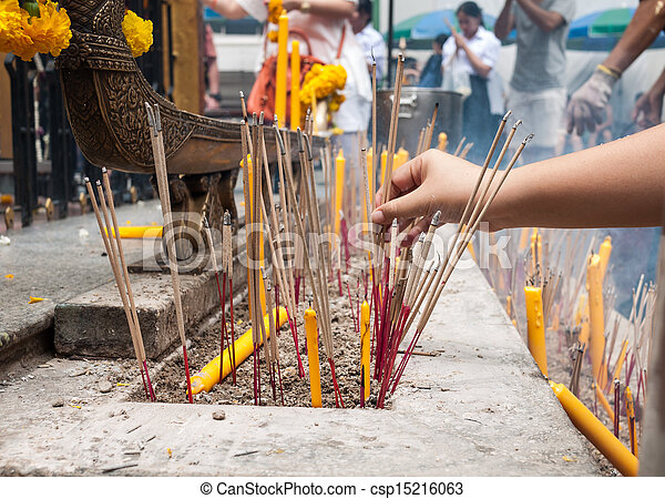 Buddhist people pray using incense and candle