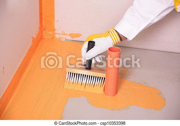 builder brush applied waterproofing on the floor of the bathroom - csp10353398