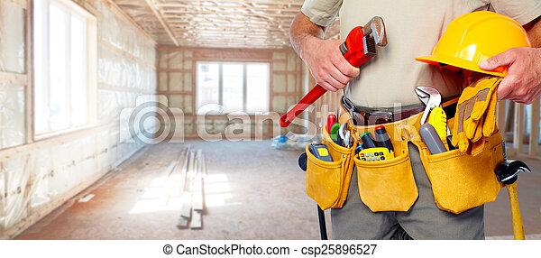 Builder handyman with construction tools. - csp25896527