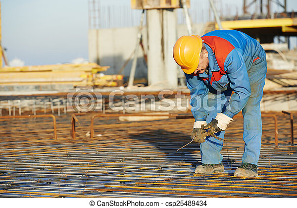 Builder making reinforcement for concrete - csp25489434