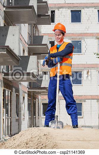 Builder taking a break from work - csp21141369