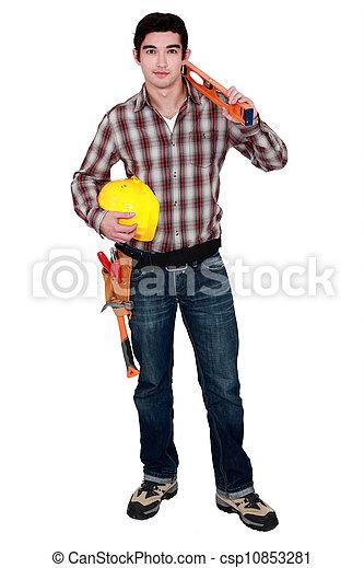 Builder with a spirit level - csp10853281