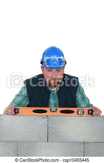 Builder with a spirit level - csp10455445