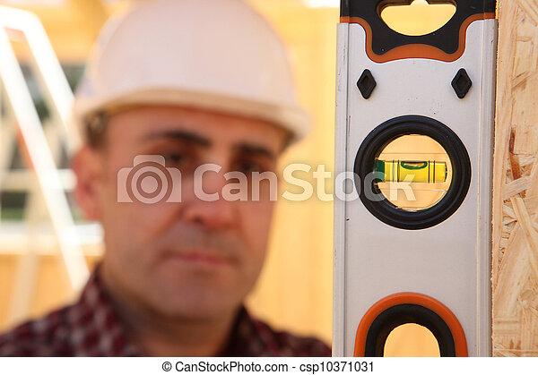 Builder with a spirit level - csp10371031