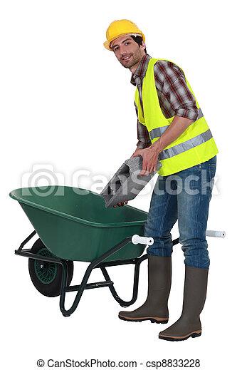 Builder with a wheelbarrow - csp8833228