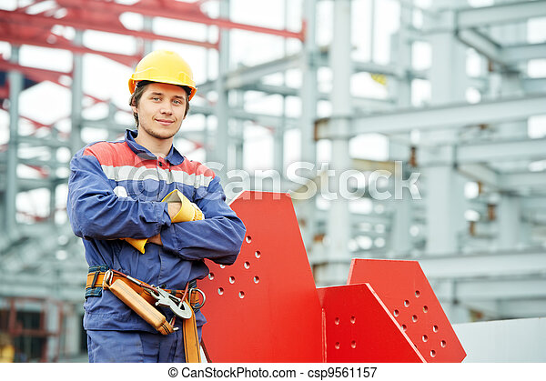builder worker at construction site - csp9561157