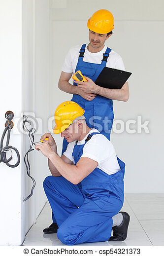 Builders working with electricity - csp54321373