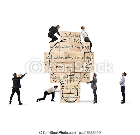 Building a new creative idea. Business person built together a big brick wall with drawn lightbulb - csp46885419