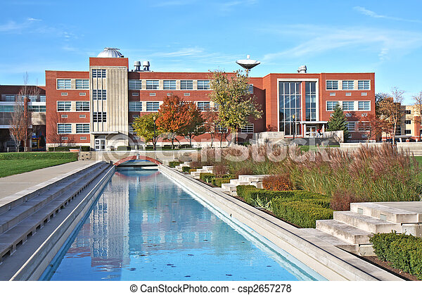 Building and reflecting pool on a university campus - csp2657278