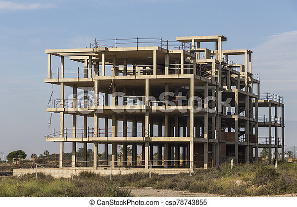 building construction site work from concrete, concrete structure of building under construction, concrete formwork, construction of the building - csp78743855