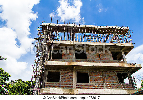 Building construction with blue sky background - csp14973617