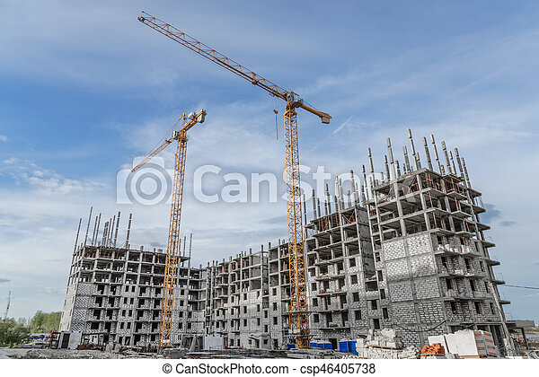 Building crane and building under construction against blue sky - csp46405738