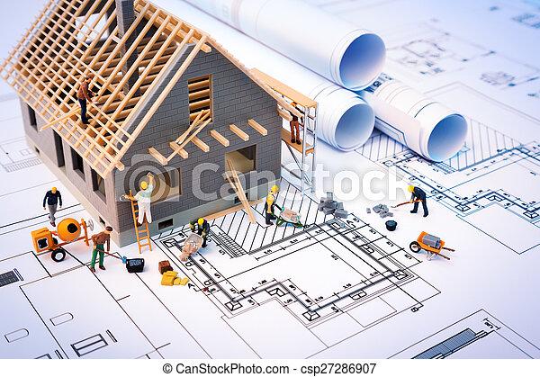 building house on blueprints - csp27286907