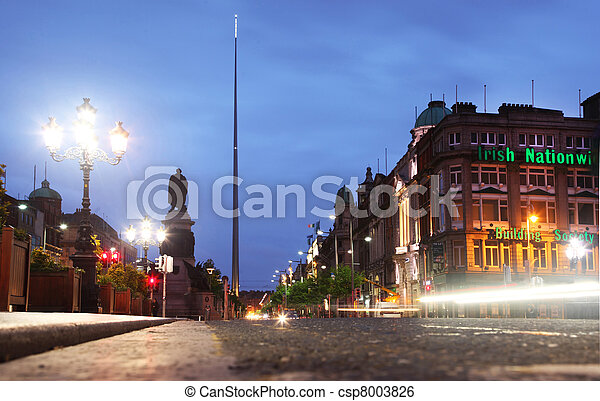 Building of Irish Nationwide Building Society and Spire of Dublin (Monument of Light) is a large, stainless steel, pin-like monument 121.2 metres - csp8003826