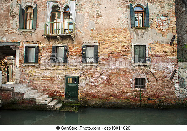 Buildings beside a canal, Venice, Italy - csp13011020