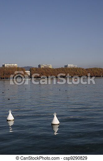 Buildings in front of annecy lake and autumn trees - csp9290829