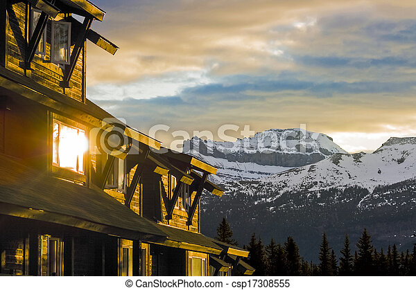 Buildings in the Mountains at Sunrise - csp17308555