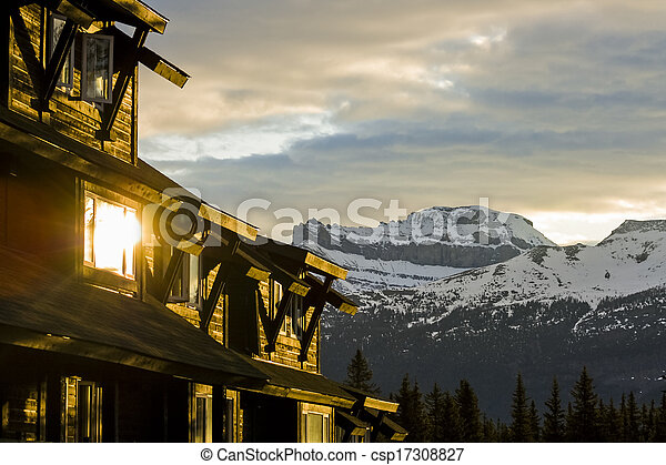 Buildings in the Mountains at Sunrise - csp17308827
