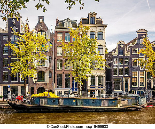 Buildings on canal in Amsterdam - csp19499933