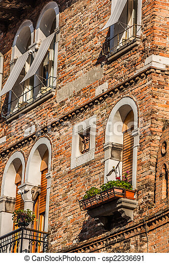 Buildings with traditional Venetian windows in Venice, Italy - csp22336691