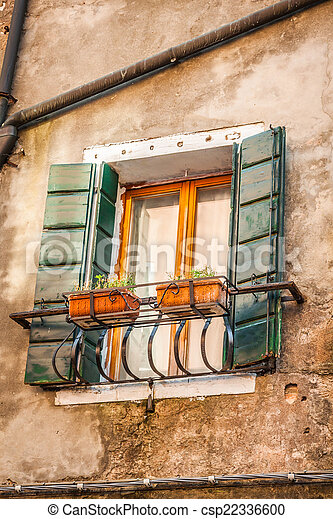 Buildings with traditional Venetian windows in Venice, Italy - csp22336600