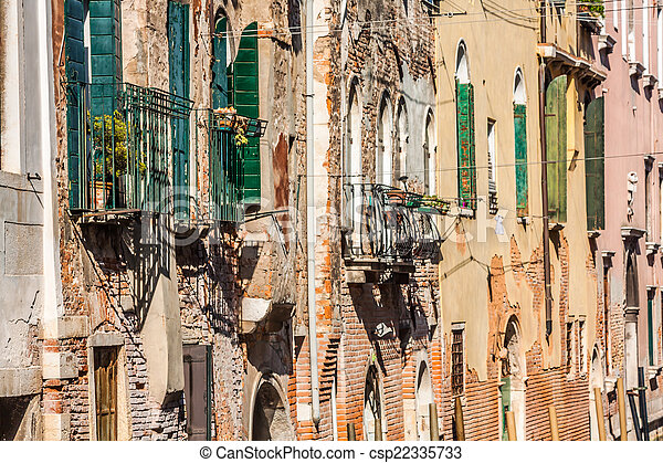 Buildings with traditional Venetian windows in Venice, Italy - csp22335733