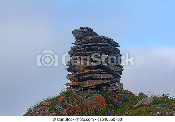Built from stone Cairn at sunset, at midnight, the polar day - csp40558780
