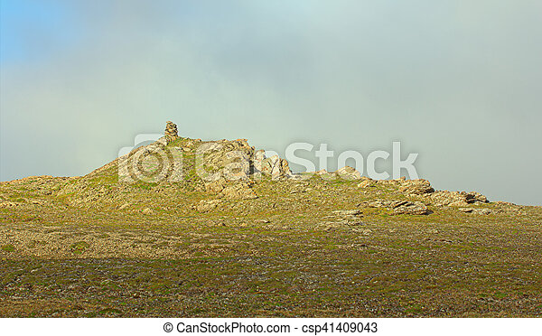 Built from stone Cairn at sunset, at midnight, the polar day - csp41409043