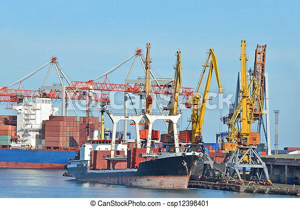 Bulk cargo ship under port crane bridge - csp12398401