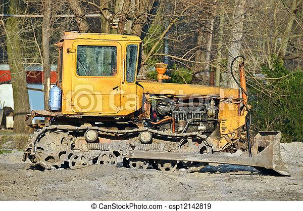 Bulldozer on road construction site - csp12142819