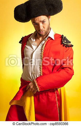 Bullfighter courage red yellow humor spanish colors  - csp8593366