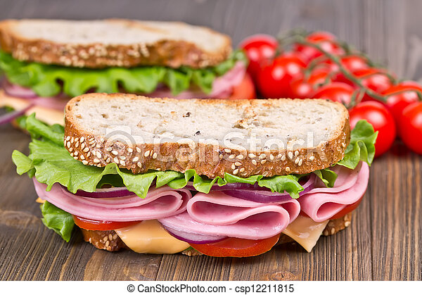 bun and sandwiches  on a wooden board - csp12211815