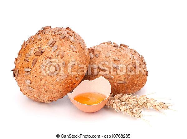 Bun with seeds and broken egg  - csp10768285