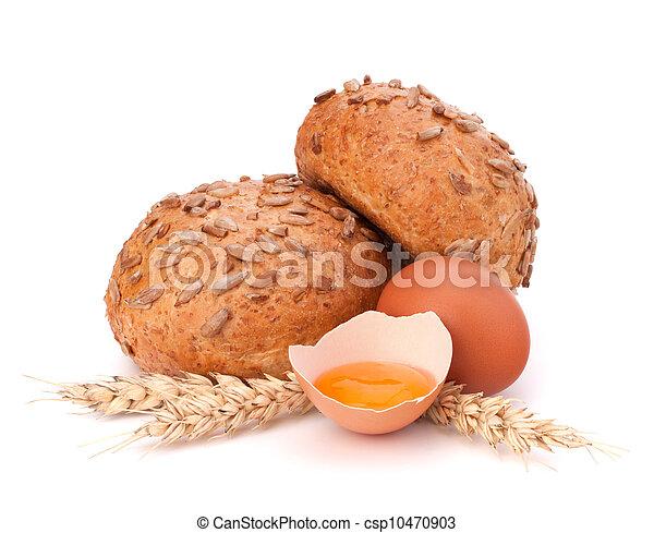 Bun with seeds and broken egg  - csp10470903