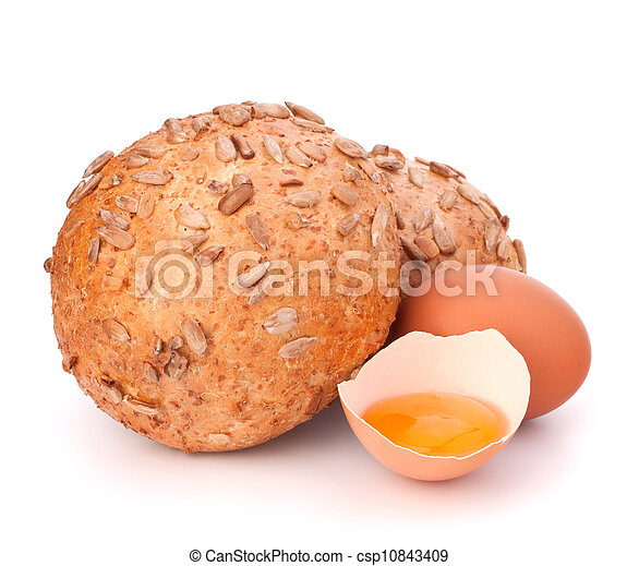 Bun with seeds and broken egg  - csp10843409