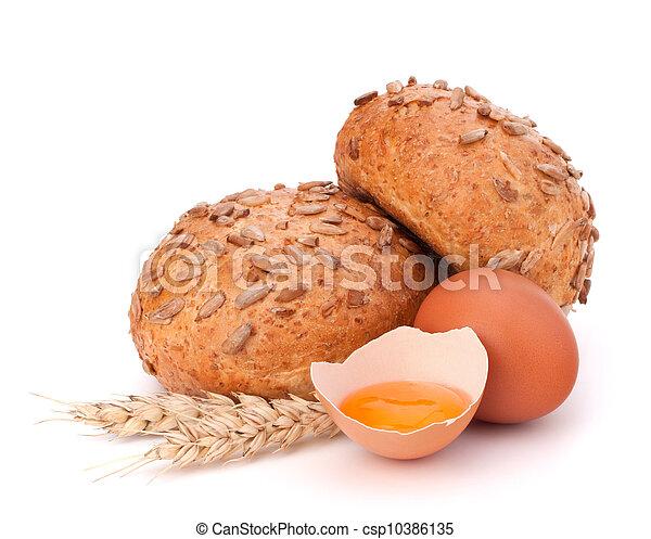 Bun with seeds and broken egg  - csp10386135