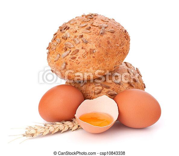 Bun with seeds and broken egg  - csp10843338