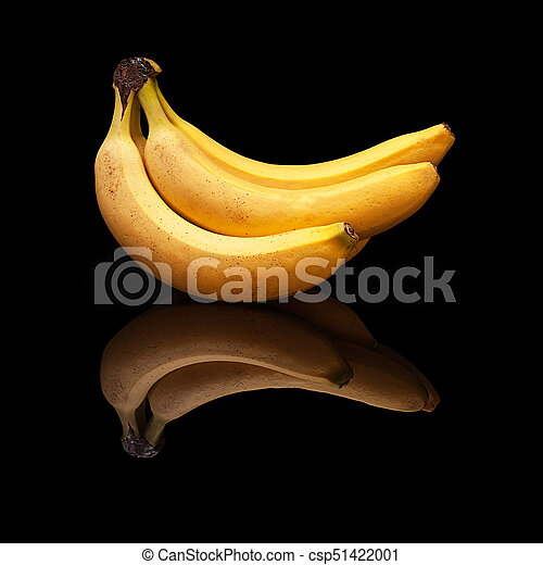 Bunch of bananas on a black background isolated - csp51422001