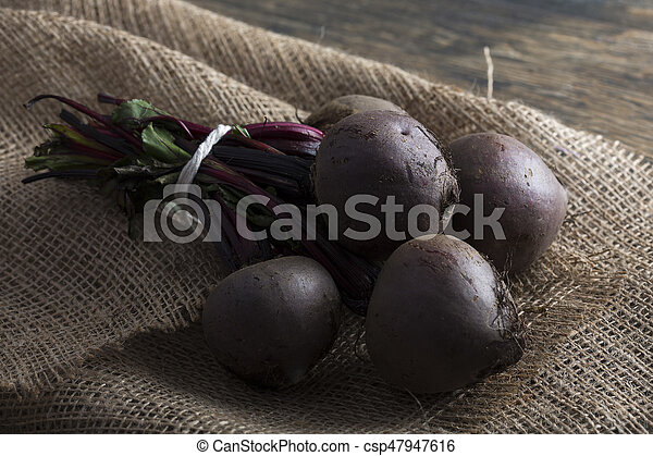 Bunch of beetroot on a brown burlap cloth close-up - csp47947616