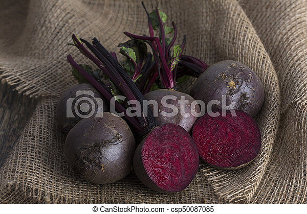 Bunch of beetroot on a brown burlap cloth close-up - csp50087085