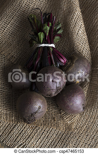 Bunch of beetroot on a brown burlap cloth close-up - csp47465153