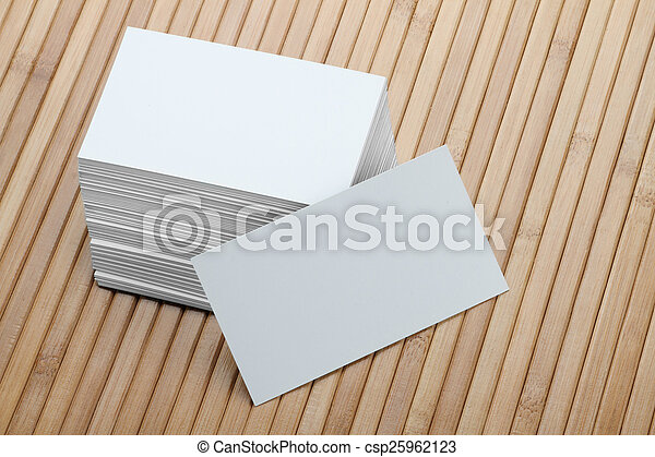 Bunch of Blank White Business Card on Wooden Background - csp25962123