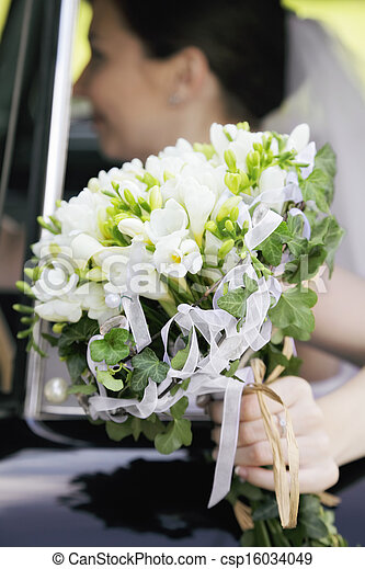 Bunch of flowers in the hand of bride - csp16034049