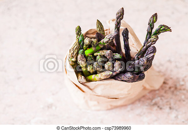 Bunch of fresh purple asparagus spears in the bag - csp73989960