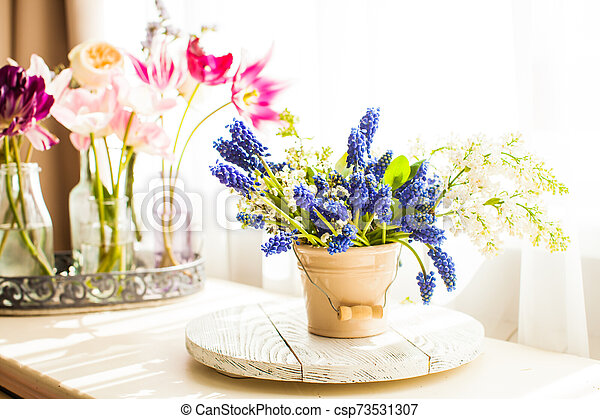 Bunch of grape hyacinths in a ceramic vase - csp73531307