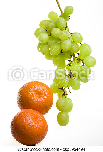 Bunch of grapes in drops of water and tangerines - csp5954494