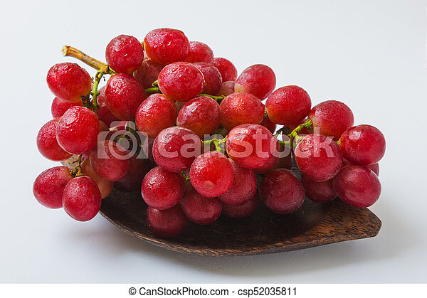 bunch of grapes on a plate - csp52035811