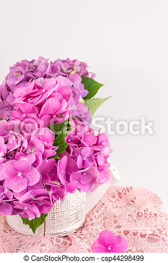 Bunch of hortensia pink flowers in a vase on white background bunch of hortensia pink flowers in a vase csp44298499 mightylinksfo