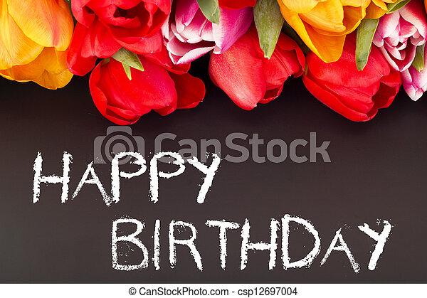 Bunch of tulips with blackboard: happy birthday - csp12697004