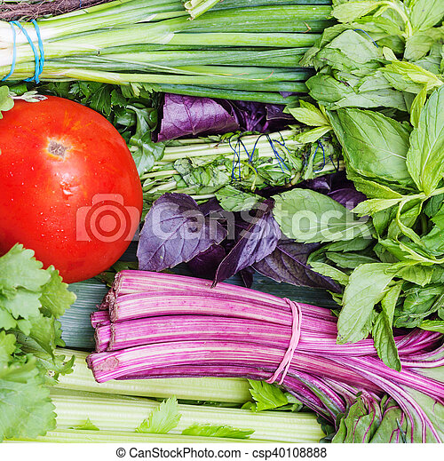 bunches of fresh cut green stuff and red tomato - csp40108888